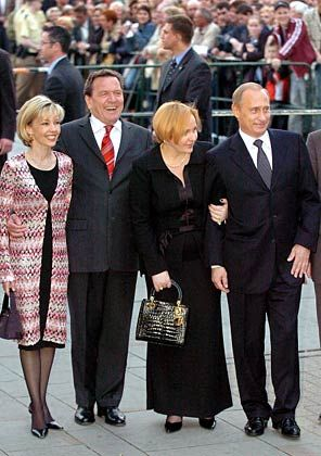 Vladimir Putin and his wife helped Schroeder celebrate his 60th birthday earlier this year.