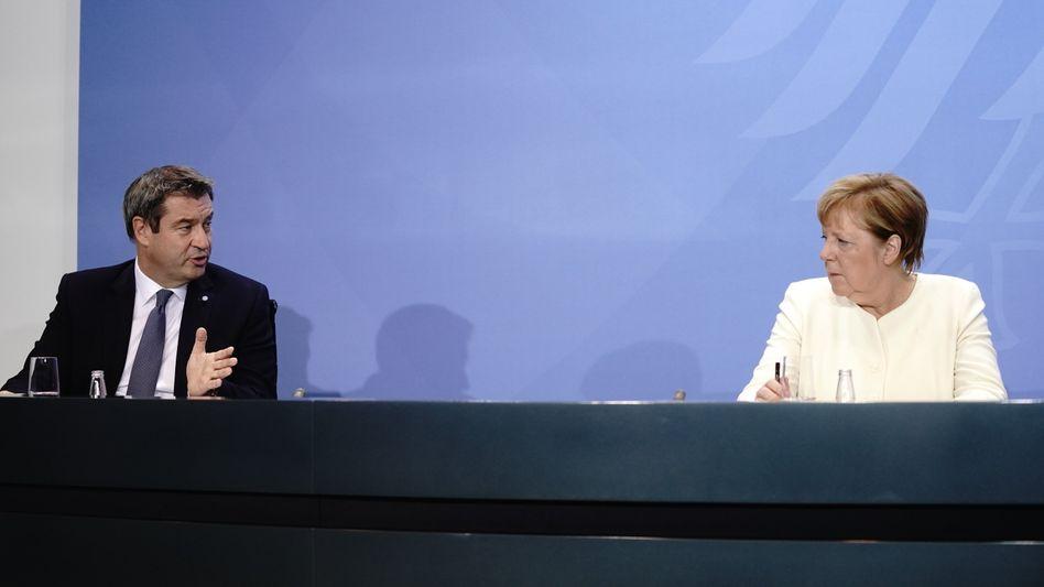 Bayerns Regierungschef Söder und Kanzlerin Merkel nach der Ministerpräsidentenkonferenz
