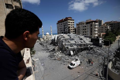 The most brutal week in years: A Palestinian looking at a bombed building.