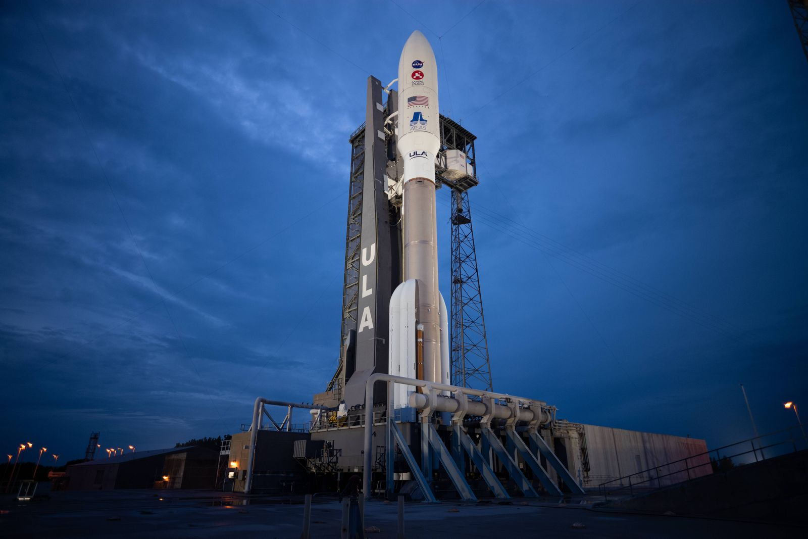 "A United Launch Alliance Atlas V rocket with NASA""!s Mars 2020 Perseverance rover onboard is seen illuminated by spotlig"