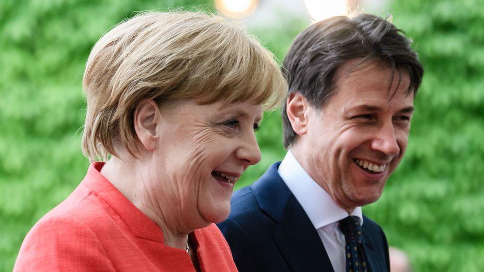 Regierungschefs Merkel, Conte in besseren Zeiten (2018): Die Liste der Vorwürfe ist lang