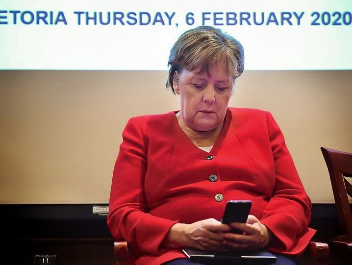"""Chancellor Angela Merkel described Wednesday's developments as """"unforgivable,"""" """"a bad day for democracy"""" that must be reversed."""