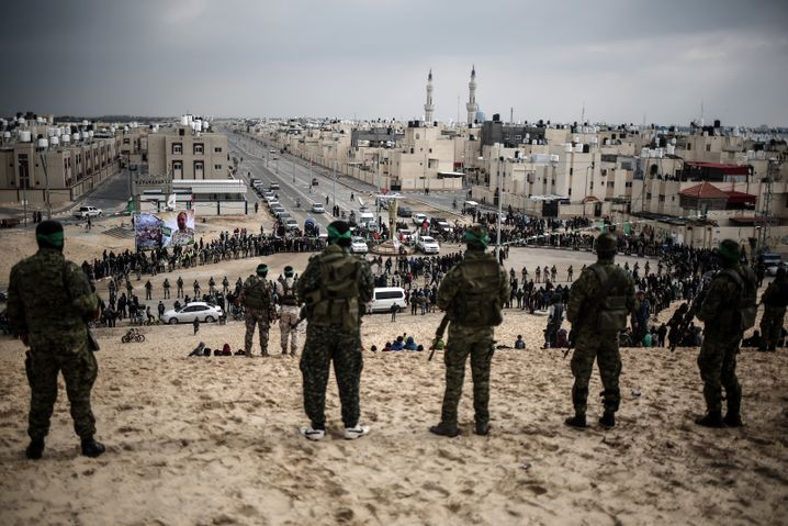 Fighters with the Qassam Brigades in the Gaza Strip