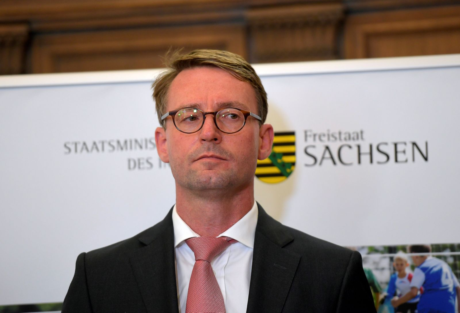 Saxony state Interior Minister Markus Ulbig looks on during a news conference in Chemnitz