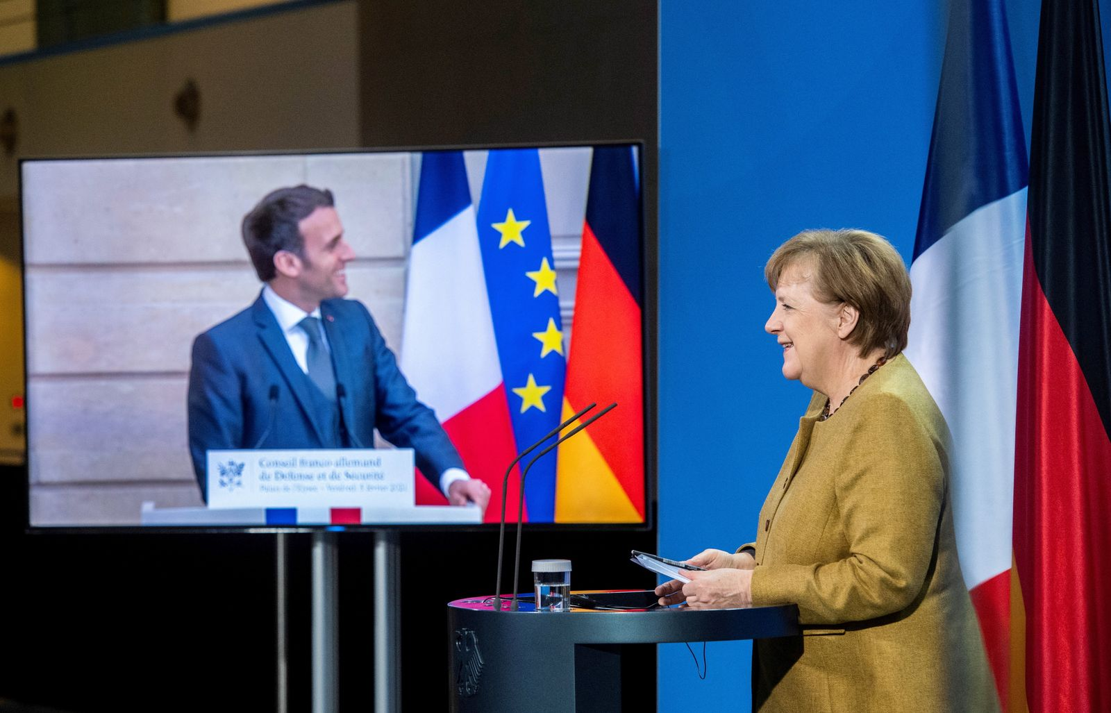 German Chancellor Angela Merkel and French President Emmanuel Macron attend a press conference in Berlin