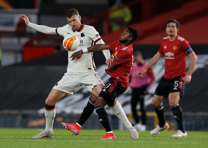 Edin Džeko (left) and Roma lost 6-2 in the first leg against United