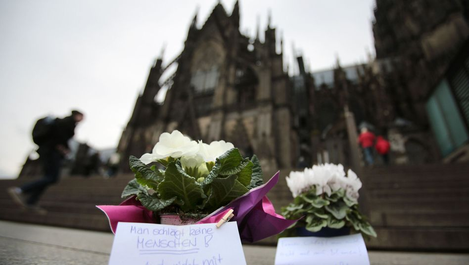Flowers on the square in front of the Cologne cathedral where dozens of women were the victims of sexual attacks on New Year's Eve.