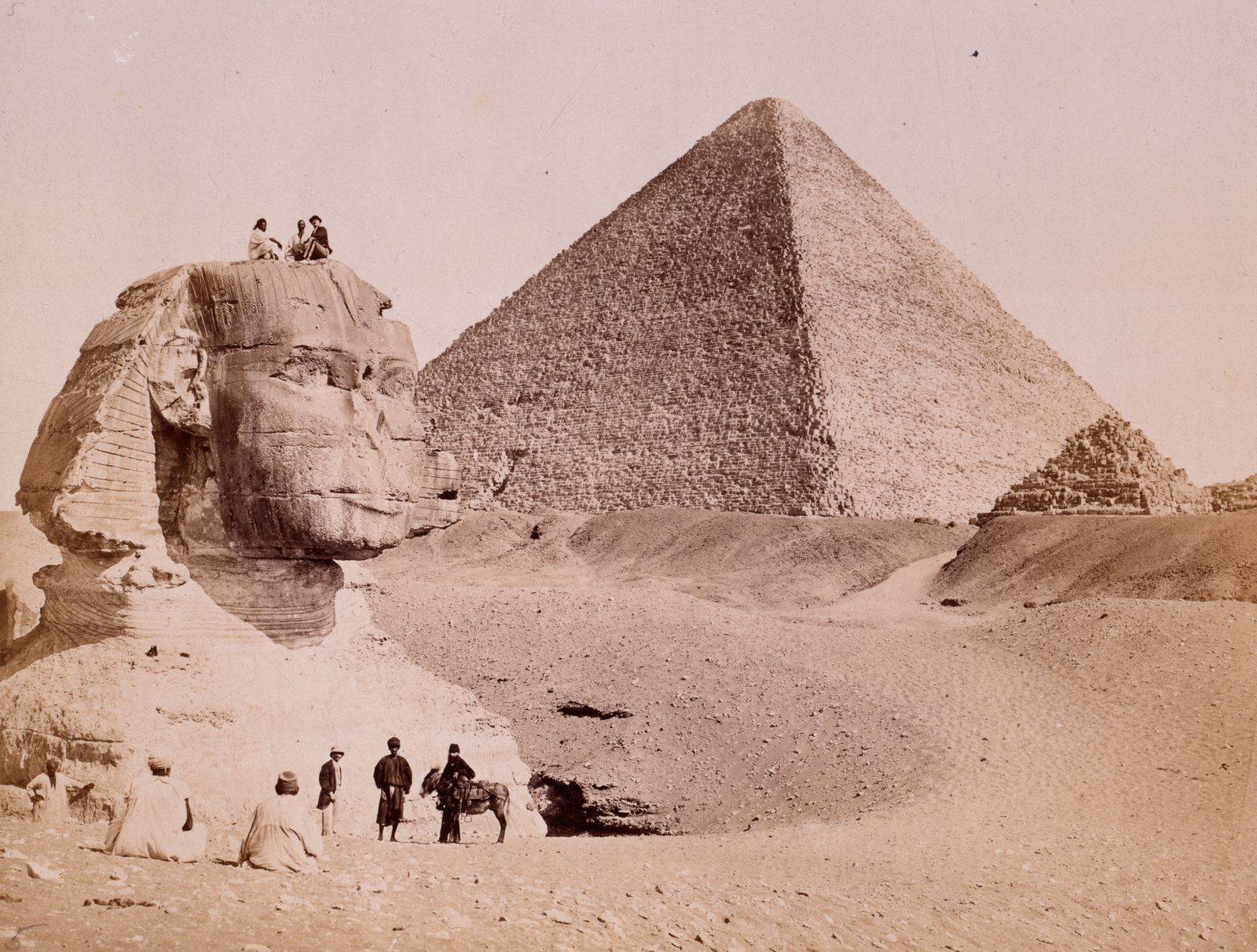 Egyptian guides with European tourists