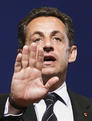 Has French President Nicolas Sarkozy smuggled protectionism into the new treaty?