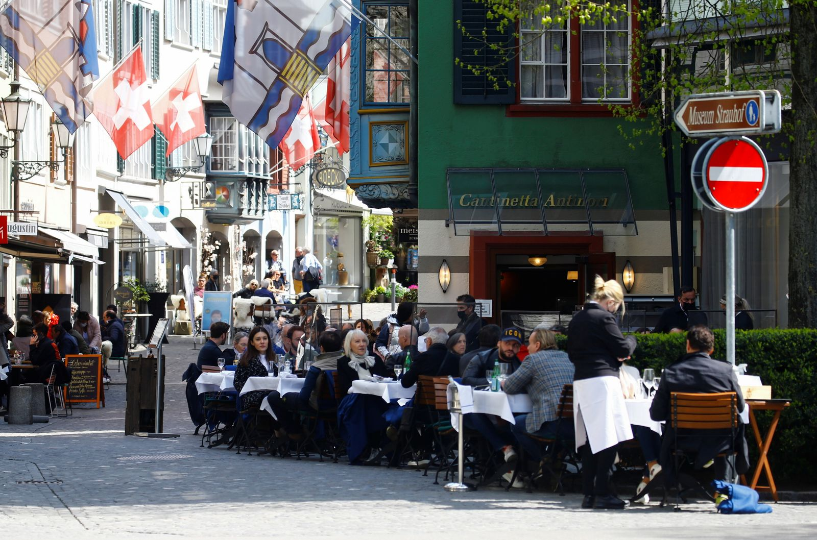 Guests sit in front of a restaurant in Zurich