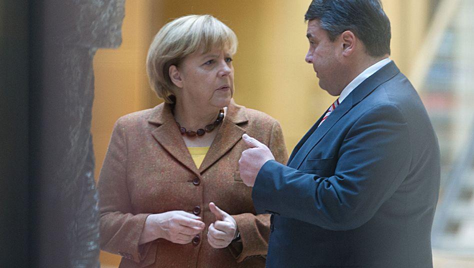 Kanzlerin Merkel, SPD-Chef Gabriel: Der Mann ist ein Spieler