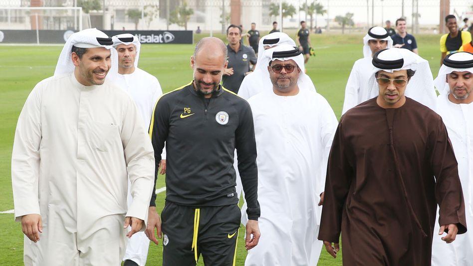 Manchester City Chairman Khaldoon Al Mubarak (left) with trainer Pep Guardiola and team owner Sheikh Mansour bin Zayed Al Nahyan (in brown).