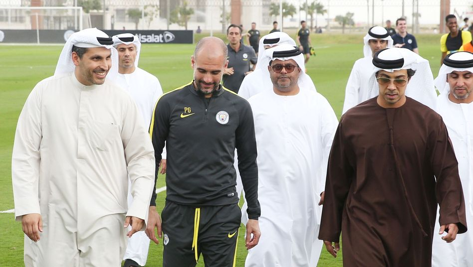 Manchester City Chairman Khaldoon Al Mubarak (left) with trainer Pep Guardiola and team owner Sheikh Mansour bin Zayed Al Nahyan (in brown).