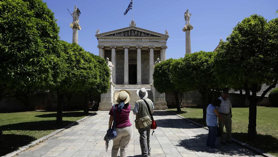 Tourists at the Athens Academy on May 7, the day after Greece's election.
