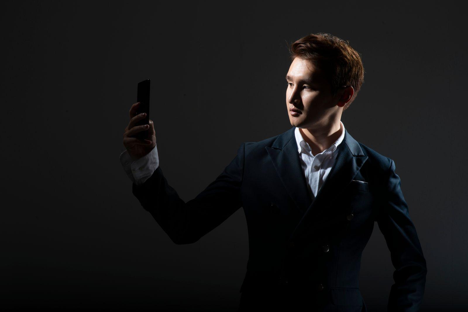 Businessman taking selfie with smartphone
