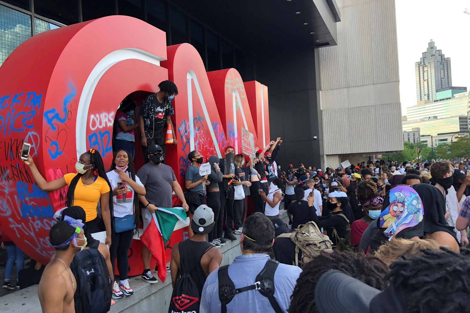 People gather at CNN Center during a protest in Atlanta