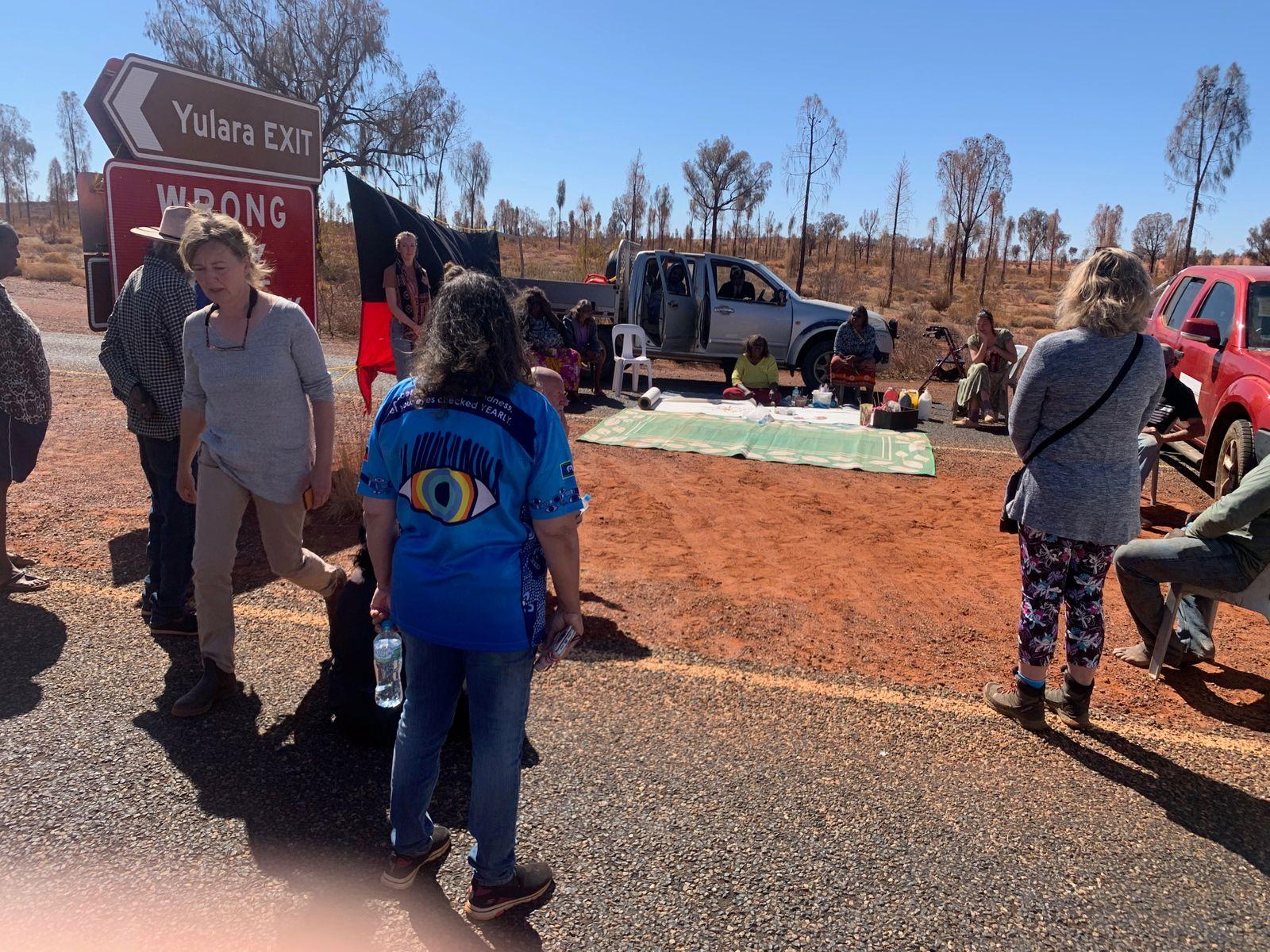 People block entry to Uluru-Kata Tjuta National Park to visitors from coronavirus hotspots, in Uluru-Kata Tjuta National Park