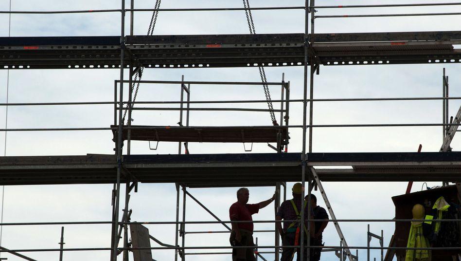 Bauarbeiter auf dem Gerüst