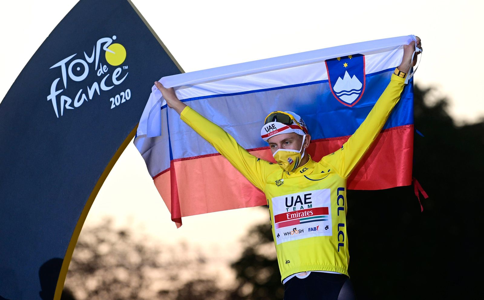 PARIS, FRANCE - SEPTEMBER 20 : POGACAR Tadej (SLO) of UAE TEAM EMIRATES pictured with the yellow jersey during the podi