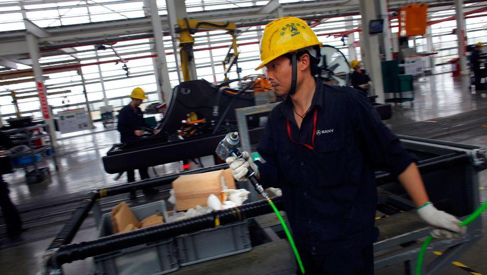 Montage bei Baumaschinenhersteller bei Shanghai: Fabriken bauen Stellen ab