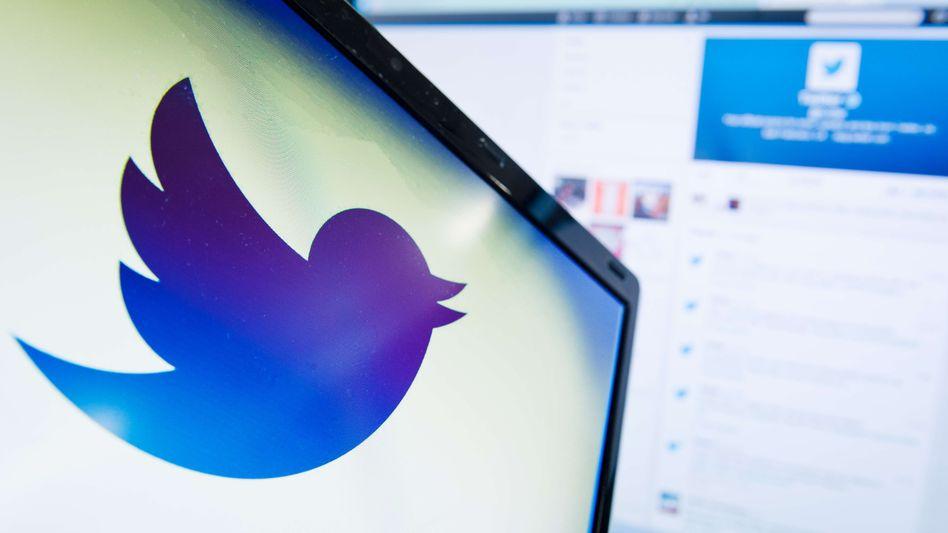 """Twitter-Logo: """"Jetzt zurück an die Arbeit"""""""