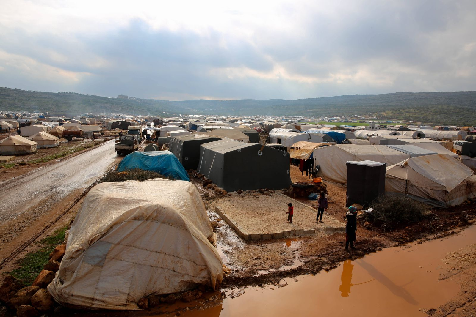January 19, 2021: Idlib, Syria. 19 January 2021. Children are exposed to the harsh weather conditions and flooding in a