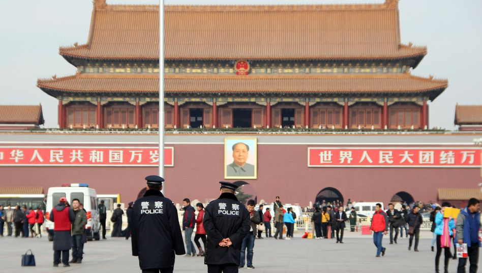 Polizisten in Peking: China gibt sich mit einem Gesetz noch mehr Macht