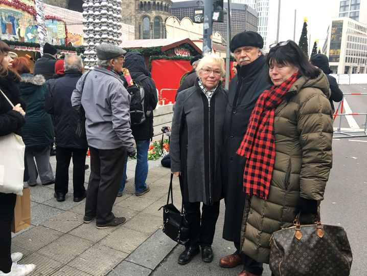 Helga und Hermann Borghorst with a friend at the make-shift memorial set up at the Christmas market where the attack happened.