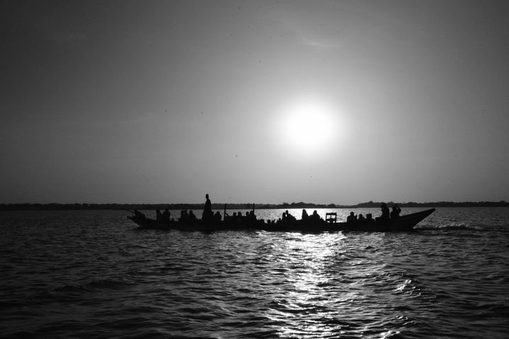Rickety wooden boats ply the waters of Lake Chad.