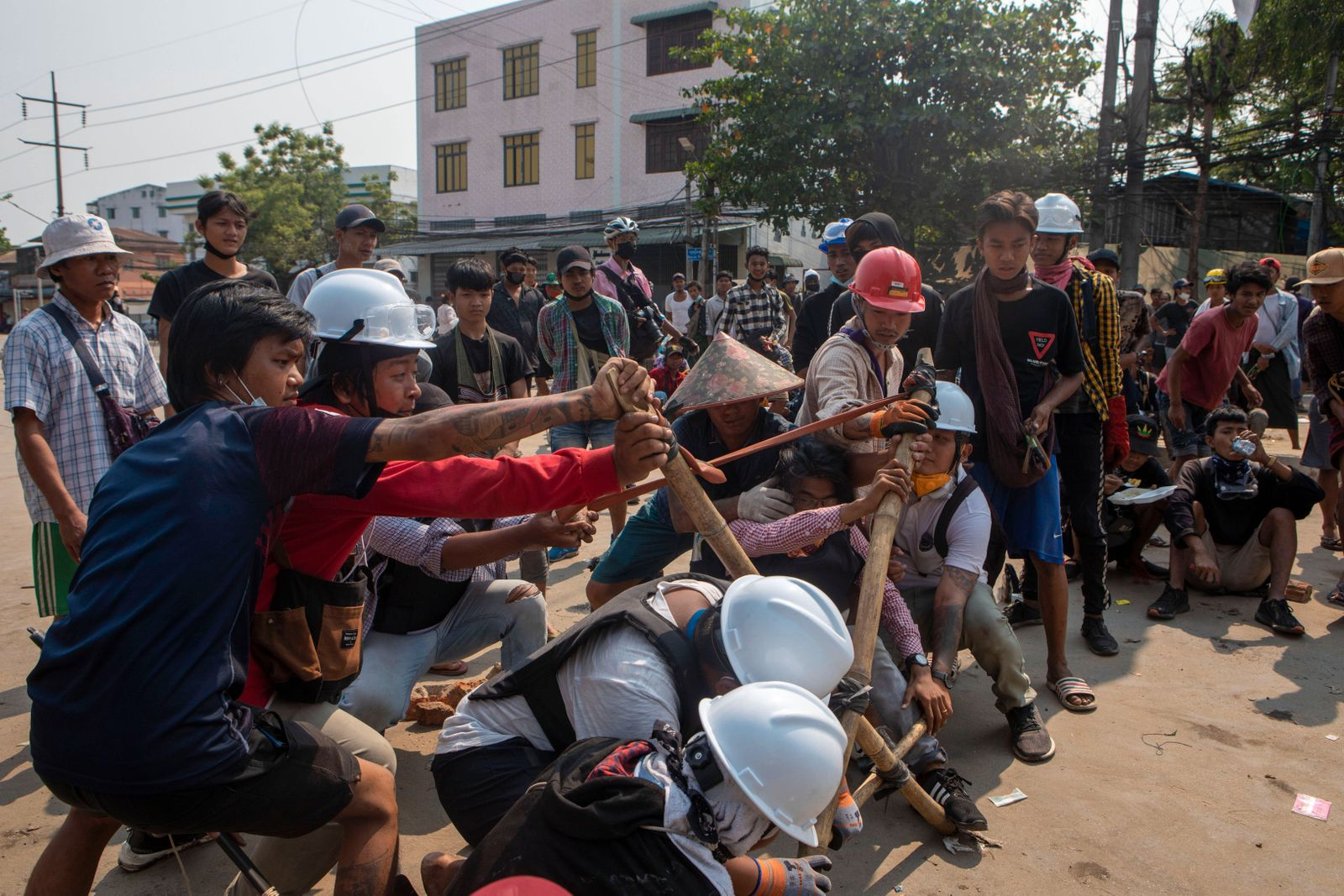 March 17, 2021, Yangon, Yangon, Myanmar: Protesters are using a makeshift catapult to fight back the armed soldiers and