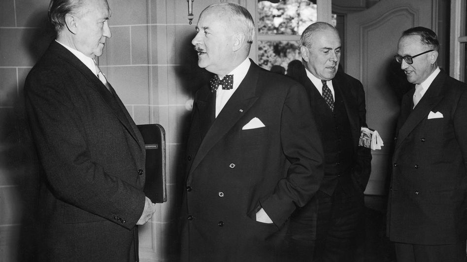 """Former German Chancellor Konrad Adenauer (left) during a meeting with the High Commission of the Allies in 1951: Eschewing of reparations demands """"a life-saving gesture"""""""