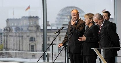 German Finance Minister Peer Steinbrück (left) and Chancellor Angela Merkel: The programs could end up consuming vast amounts of money without having any significant effects on the economy.