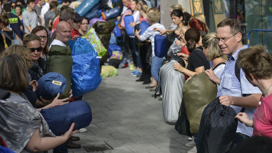 Freiwillige am Münchner Hauptbahnhof: Wir werden immer mehr, aber immer einsamer