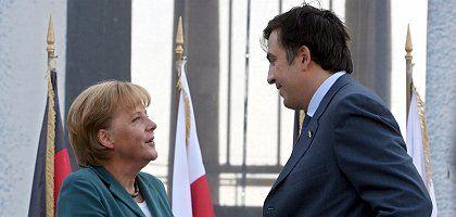 German Chancellor Angela Merkel has long been a skeptic of Georgian President Mikhail Saakashvili, but is that now changing?