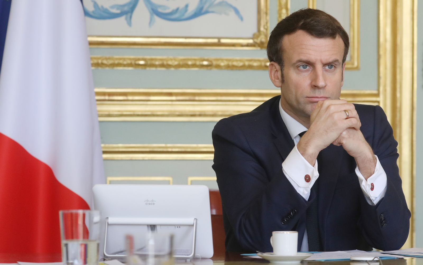 """French President Emmanuel Macron takes part in a videoconference of the """"economic task force"""", at the Elysee Palace"""