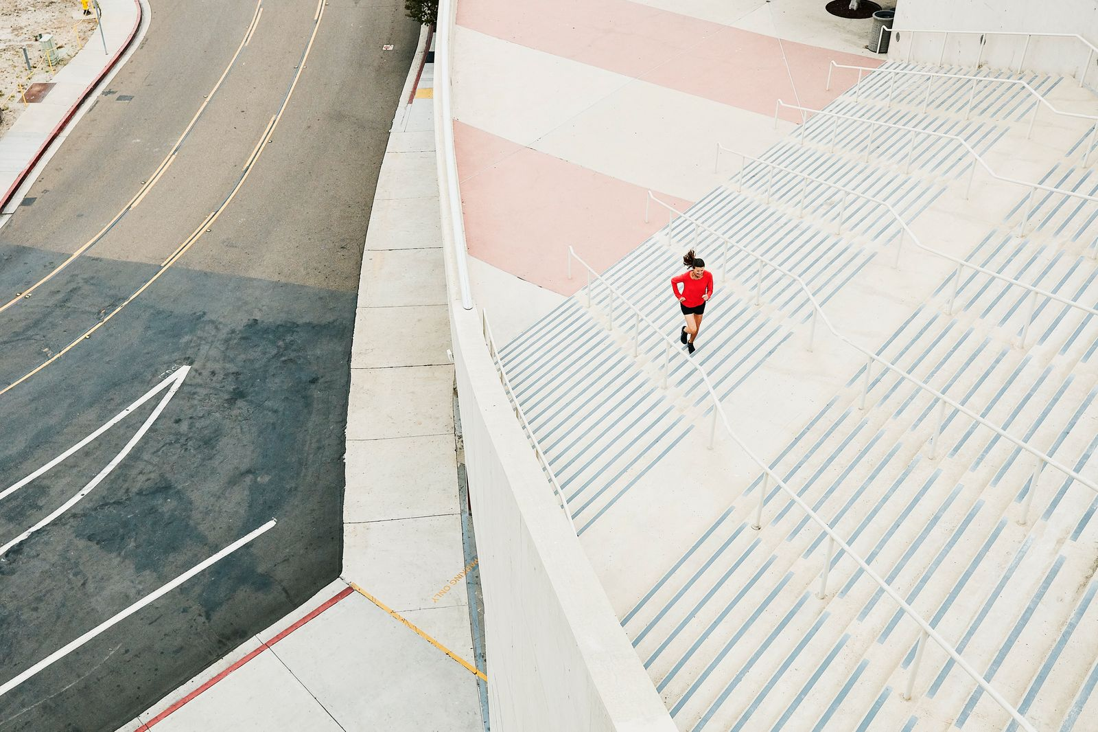 Overhead view of mature woman running stairs during workout