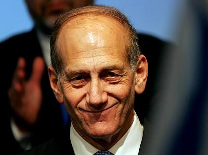 "Olmert smiles after early exit polls in Israel""s general elections showed the victory of his centrist Kadima party."