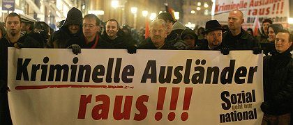 """Once again, integration has become part of an election campaign in Germany. As has often been the case, the outcome has not been pretty. Here, right-wing protesters in Munich last week hold a sign reading """"Criminal Foreigners Out!"""""""