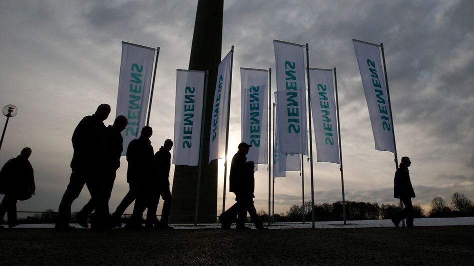 Siemens-Flaggen in München: Bürokratie hat auch Gesichter