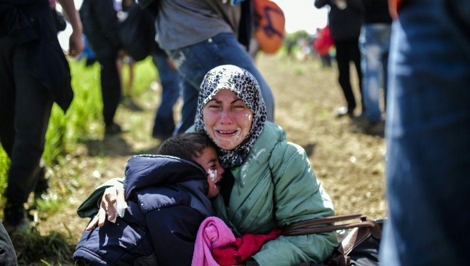 Mutter mit Kind in Idomeni