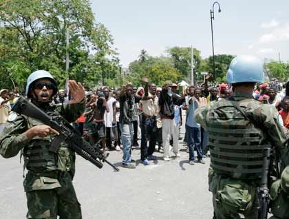 U.N. peacekeepers took to the streets in Haiti on April 8, after riots in Port-au-Prince over the cost of rice killed five people.