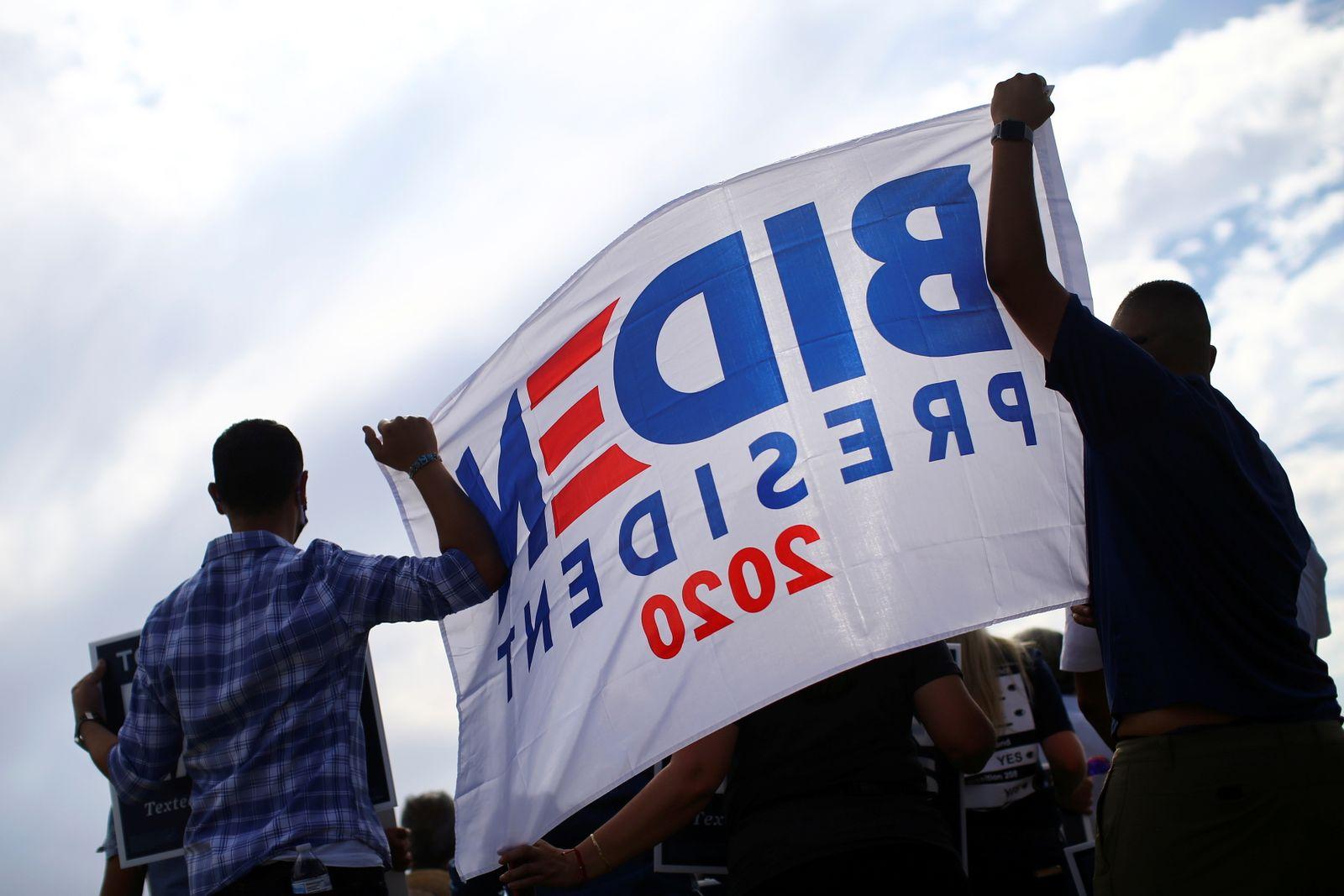 People attend an event in support of Democratic U.S. presidential nominee Joe Biden at a public park in Phoenix, Arizona