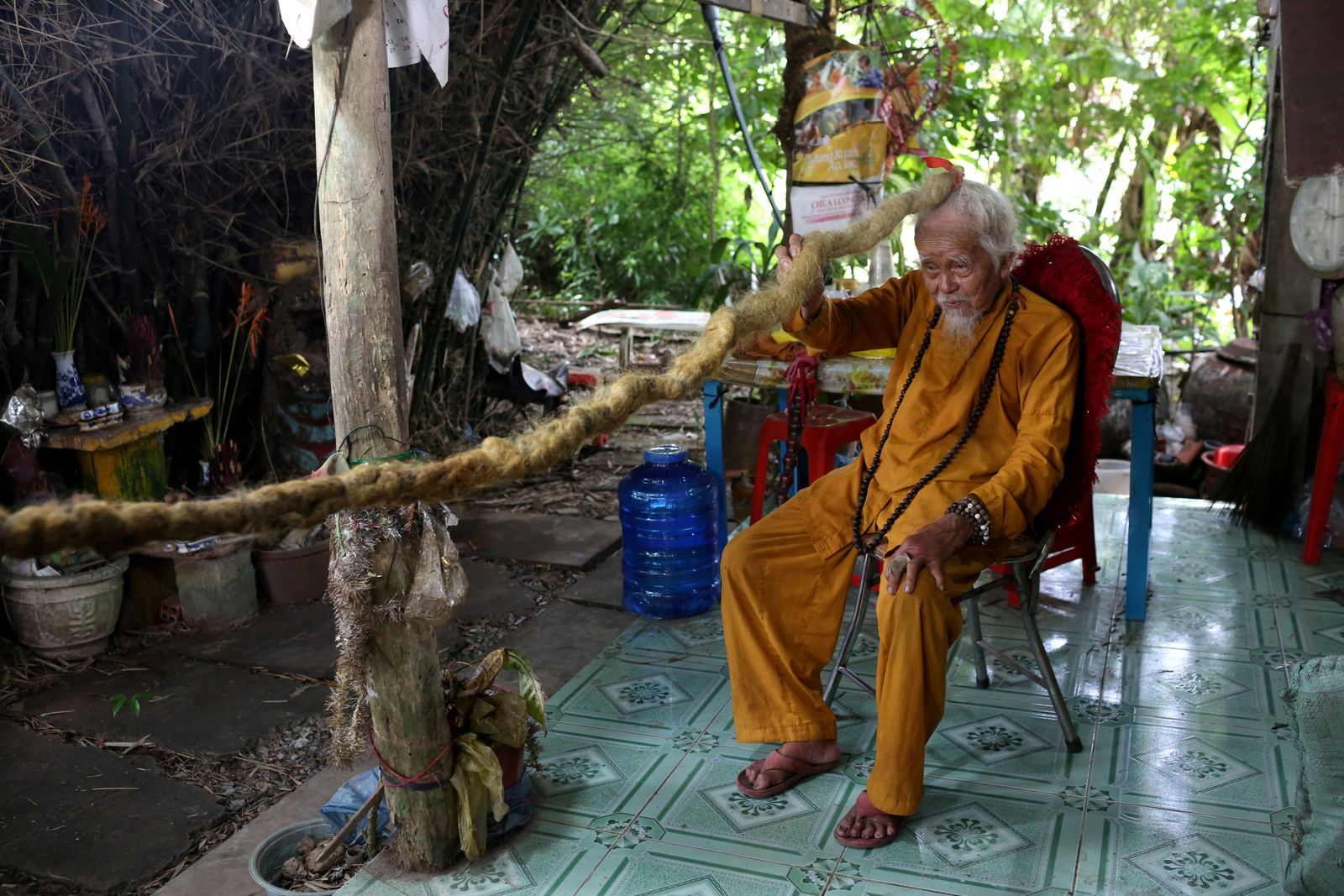 A 92-year-old man poses with his five-meter long hair in Vietnam
