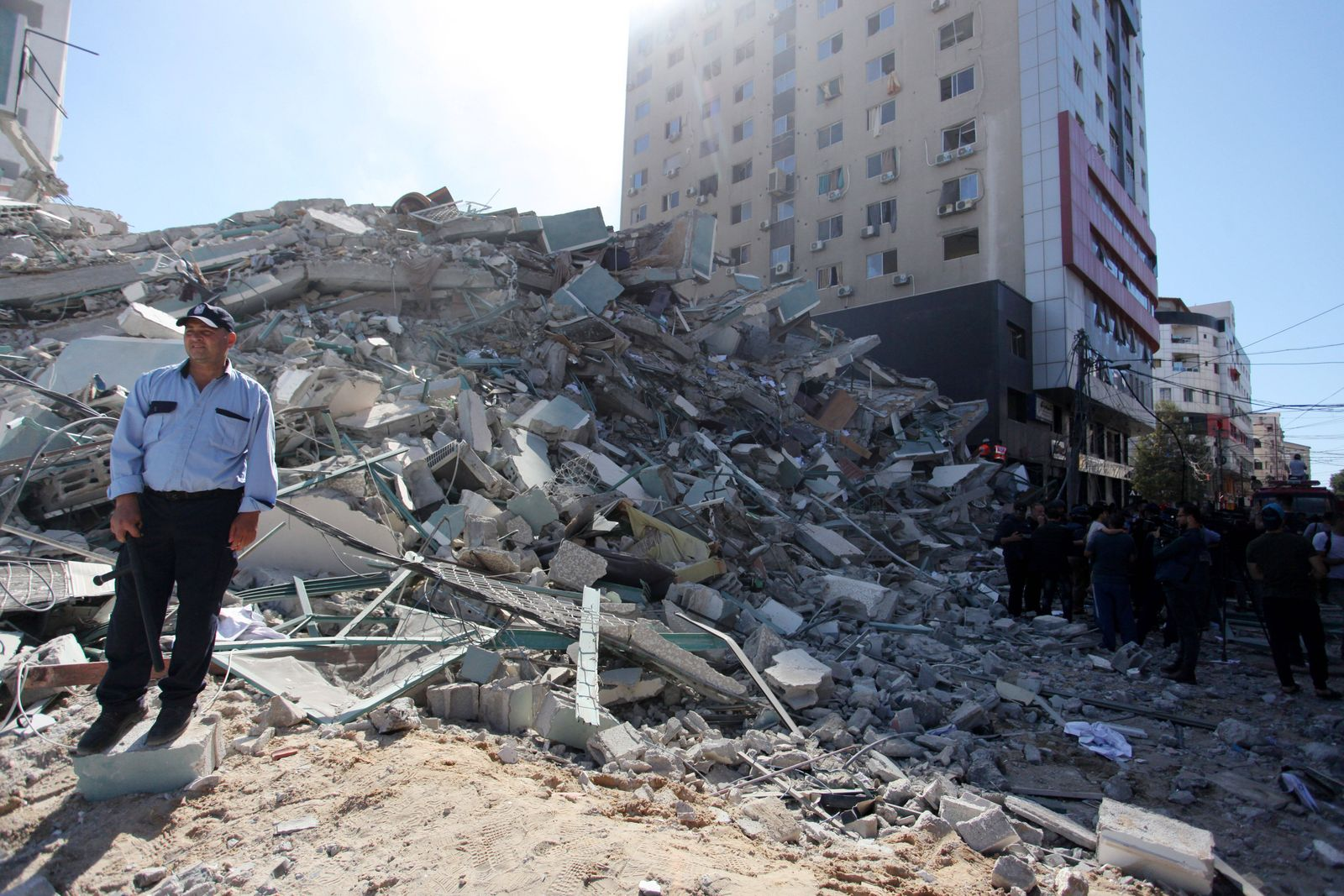 May 15, 2021, Gaza city, Gaza Strip, Palestinian Territory: Palestinians inspect the rubbles of the Jalaa Tower after i