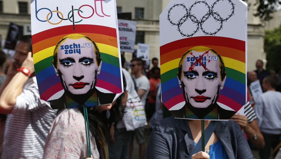 Activists in London display placards mocking Russian President Vladimir Putin during an August 10 protest of the new anti-gay 'propaganda' law in his country.