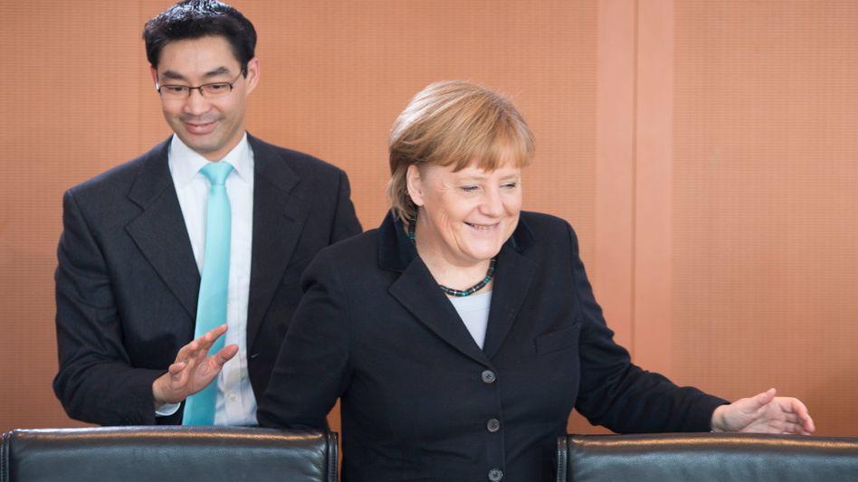 Politiker Merkel, Rösler: Hoffen auf schwarz-gelben Erfolg