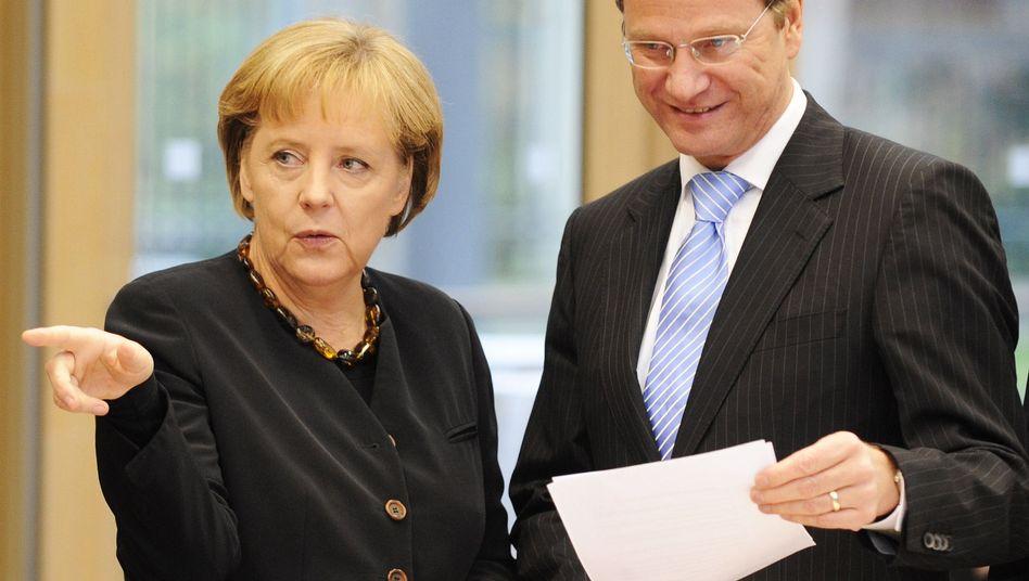 CDU-Chefin Merkel, FDP-Chef Westerwelle: Finanzrahmen festgelegt