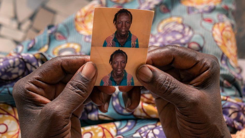An old passport photo of Lansana Bangoura, who died on his way to Europe.