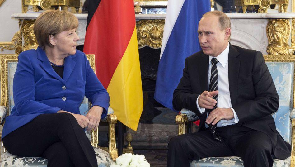 Bundeskanzlerin Angela Merkel, Russlands Präsident Wladimir Putin (Archivbild)