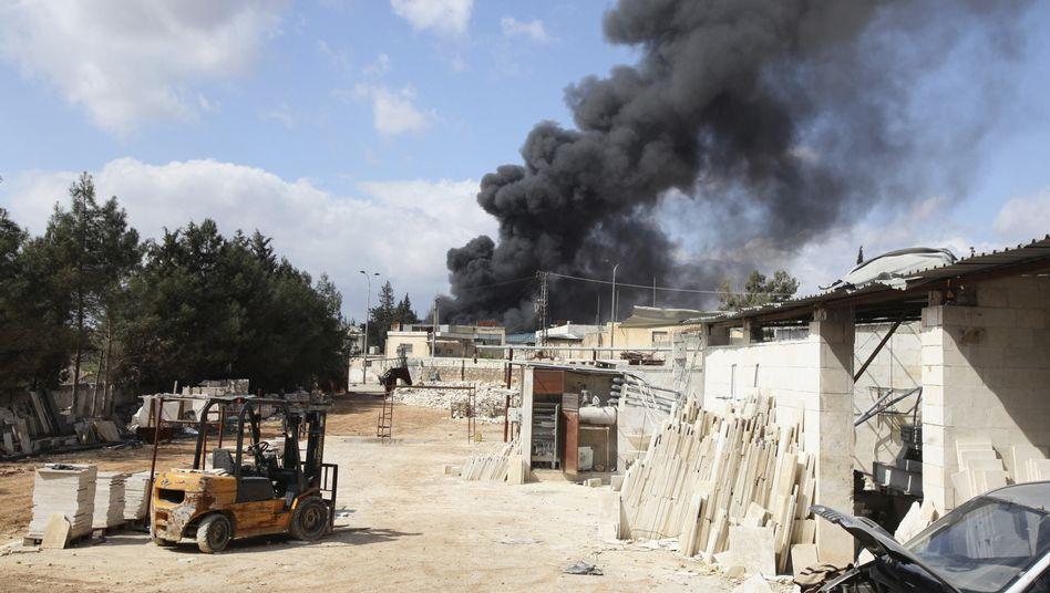 Rauchschwaden über Aleppo: Terroristen haben offenbar 22 Menschen hingerichtet